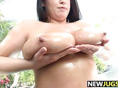 Big tits brandy talore shows off and oils up poolside