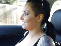 Brunette porn star with tattoos all over rides and devours dick