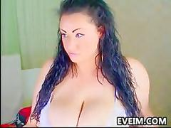 Large and busty chick teasing