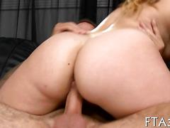 Busty blonde spoon fucked in her tattooed lovers arms