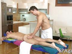 Stud gets seduced into bareback sex with his masseurs busy hands