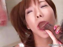 Asian babe sucking two cocks