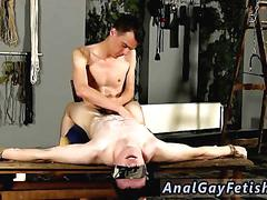 Blindfolded twink squirms and moans while getting covered with hot wax