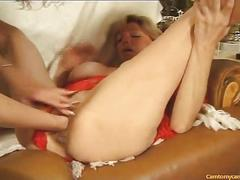 Ripe blonde gets her pussy fist fucked by a busty granny
