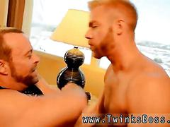 Bearded blond stud seduces a big bear into dick sucking