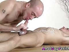 Twink gets his face fucked in bondage on a table