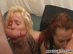 2 naughty amateur milf in a gangbang with facials