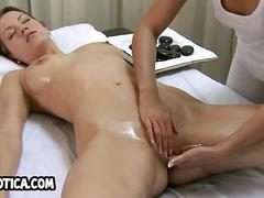 Sexy lesbian babe getting massaged and fingered