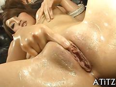 Rubbing on her wet pussy before she erupts herself