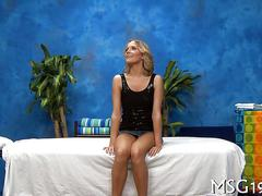 Skinny blonde teen teasing a massage client in her black thong