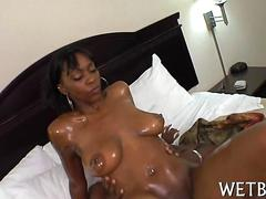 Shaved ebony goddess fucked with a fat cock close up