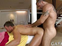 Tattooed mature masseur nails a slippery clients ass doggy style