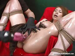Bound asian gets her pussy dildo fucked