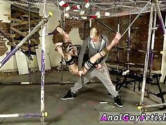 Blond master toys a twink in suspension bondage with double dildo