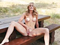 Burning hot blonde maya rae toying by the river
