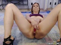 Milf fucks pussy on webcam