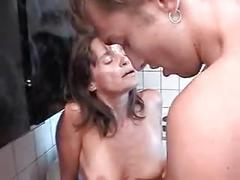 Mature woman fucks younger guy in kitchen