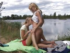 Two lesbians playing near the lake