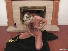 Tattooed blonde masturbates in front of the fire place