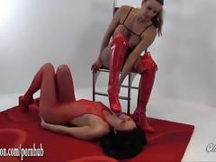 Horny babe in nylon body suit licks lezdoms boots and fucks big strapon