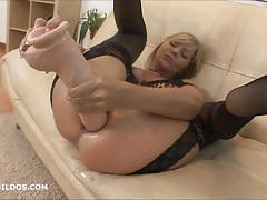 Blonde milf toys her ass