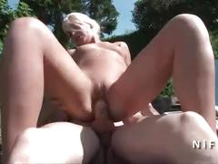 Amateur old french couple analyzing an other younger couple outdoor