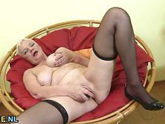 Mature blonde plays with her warm slot