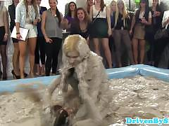 Horny wrestle in the mud