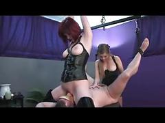 Two mistresses fucking and playing around with their slave