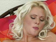 Perfect blonde fingers her pussy and plays with vibrator