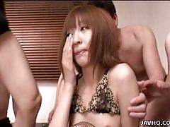 Japanese brunette enjoys gangbang
