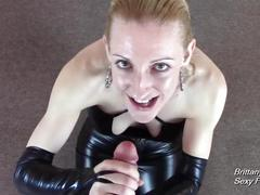 Leather clad slut gives pov blowjob and handjob for cumshot across big tits