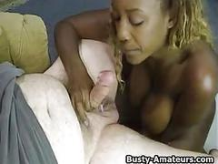 Busty ebony titfucked and sucking