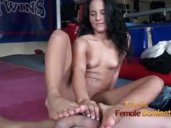 Sexy brunette takes advantage of a slave