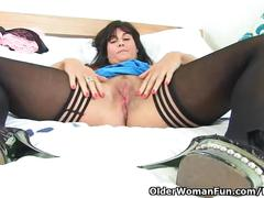 British milf lelani strips off and masturbates in stockings
