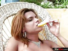 Cute shemale strokes her ladystick with fruit juice outdoors