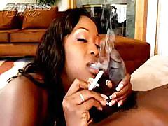 Ebony whore sucks, smokes and swallows