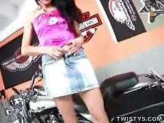 Biker chick gets dirty in garage