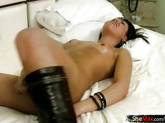 Brunette shemale shows off her oiled up ass and big dick