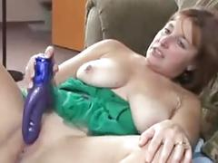 Busty granny toys her old cunt
