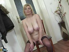 Mature blonde plays with her warm pussy