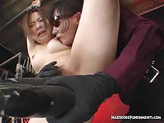 Naked oriental tied up and treated to orgasm