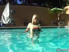 Hot blonde plays in hotel pool