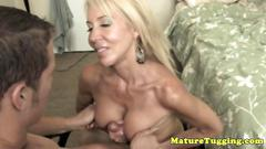 Busty mature tugs and tittyfucks a hard cock