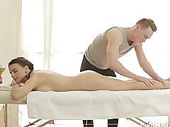 Teen beaut riding her masseur's shaft