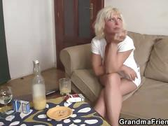 Mature widow busy sucking and fucking two dicks