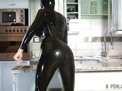 Tall slender chick posing in a black latex uniform