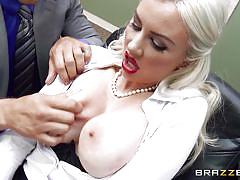 Busty blonde playing dirty at work