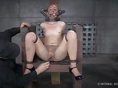 Fragile blondie tied in chains and metal bars