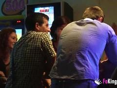 Tania greatly fucks two guys in a bar while everyone watches